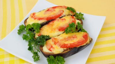 Stuffed eggplant with tomato and cheese
