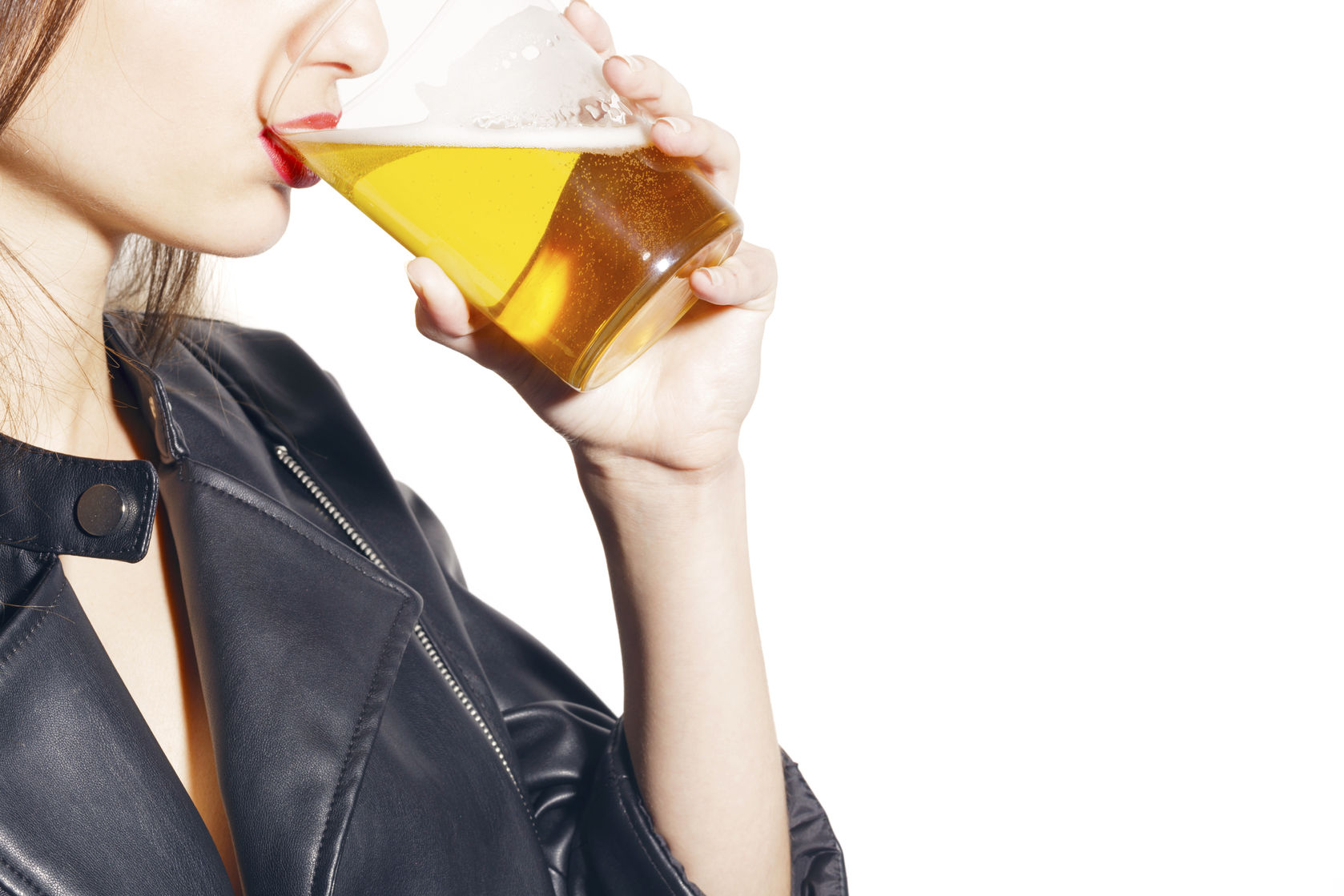 76508064 - girl with a glass of beer, on black lingerie and a leather jacket, over a white background. no face.